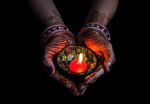 Diwali lamp in hand